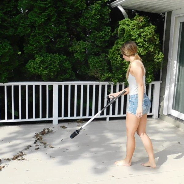 A young woman using the ZoomBroom Tornado, which made the list for one of the best pieces of outdoor equipment to have in 2022.
