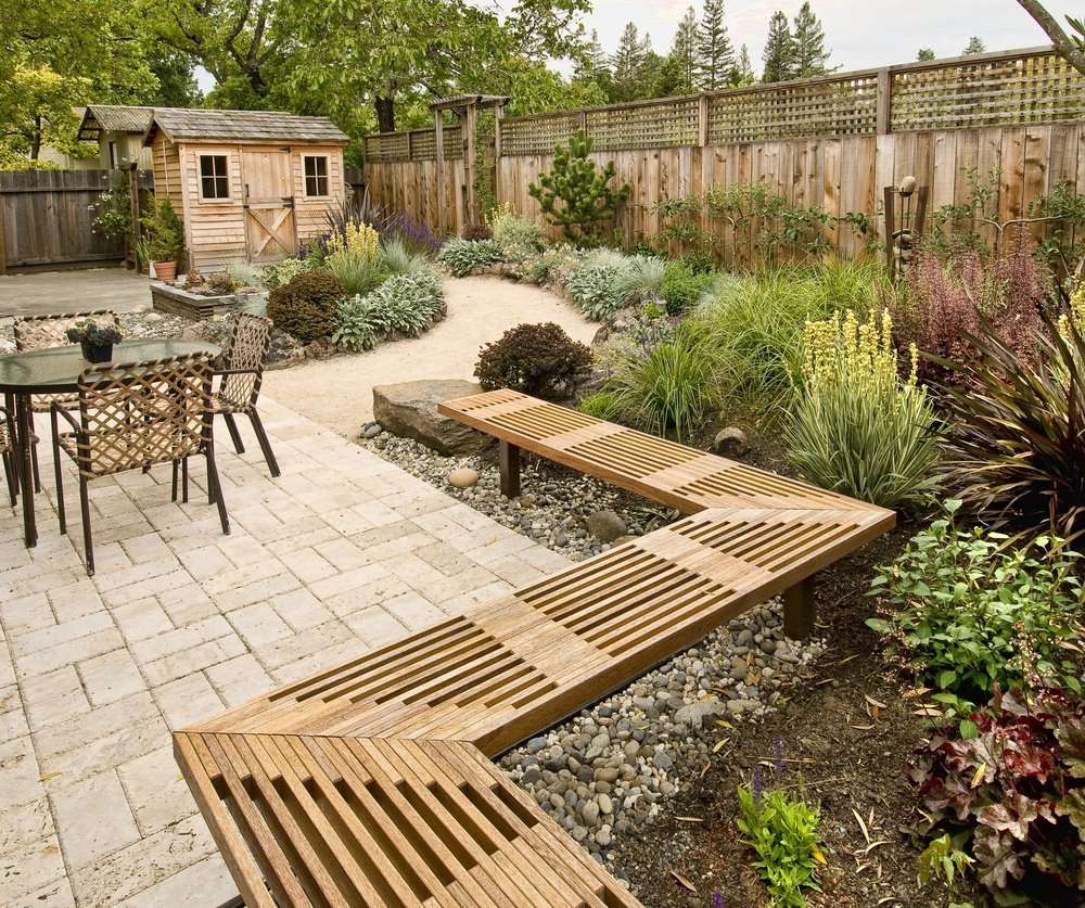 An image of a beautiful outdoor living surface and clean, green yard thanks to the help of the ZoomBroom to eliminate leaves and other debris outdoors.