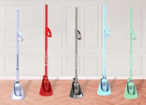 An image of the ZoomBroom Tornado in five different colors in their respective floor charging stands, an alternative to gas leaf blowers.