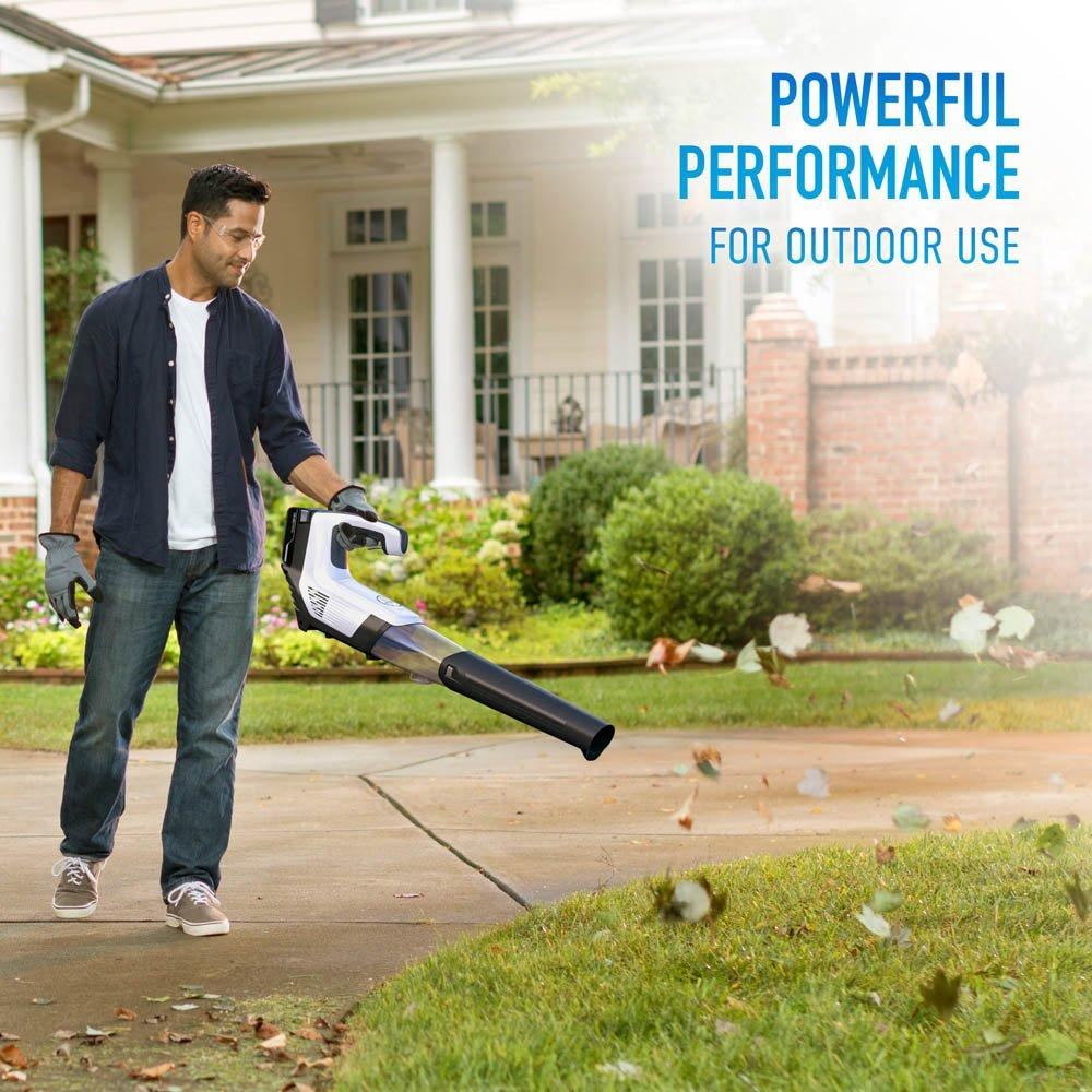 A man using the ZoomBroom Tornado to clean leaves and debris from his yard - ZoomBroom